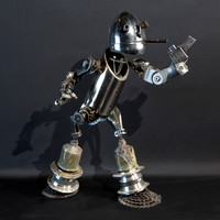 "Cigs:  tig welded found metal figure,  21"" tall, 2011"