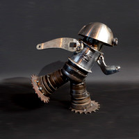 "Sprint:  tig welded found metal figure, 9"" tall, 2010"